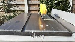 Kity 419 Table Saw with extension tables, sliding carriage & 2no unused blades