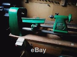 Wood turning lathe by coronet Plus tools, chuck, chisels, bench, and wood